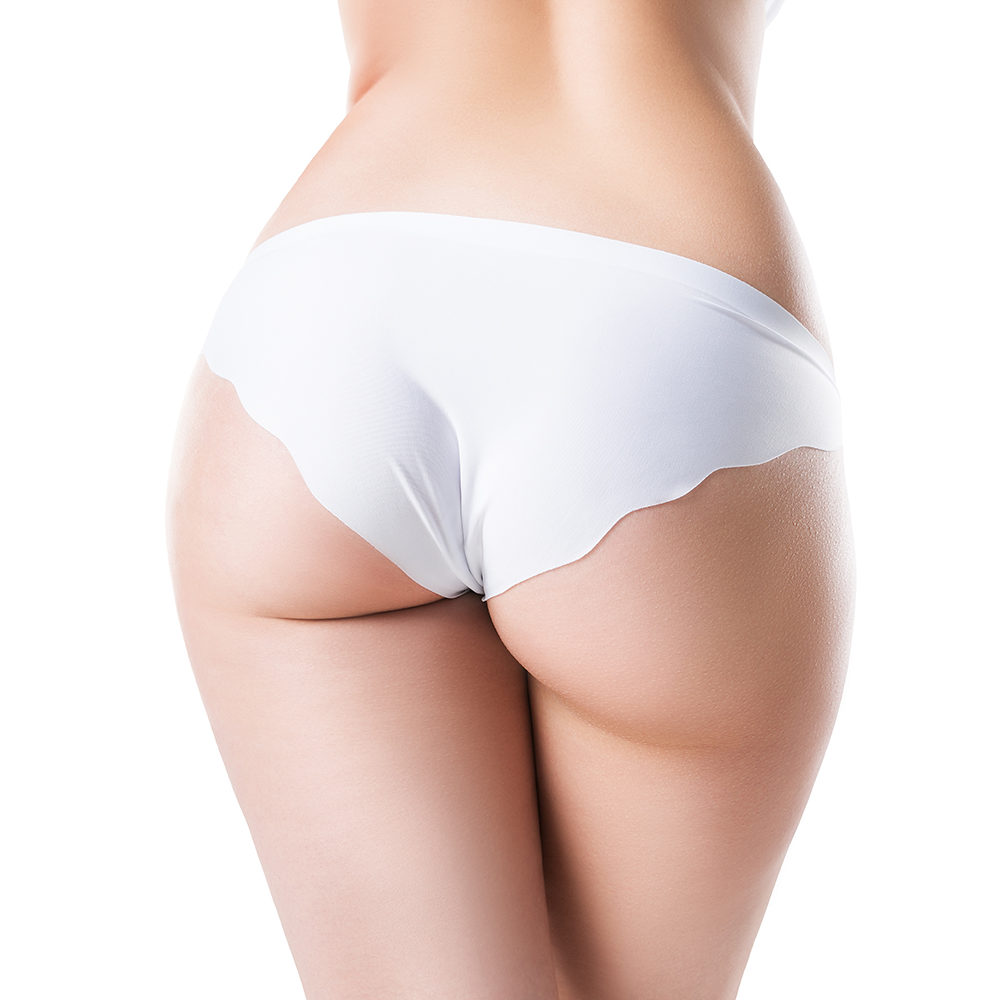 Perfect female buttocks isolated on white studio background