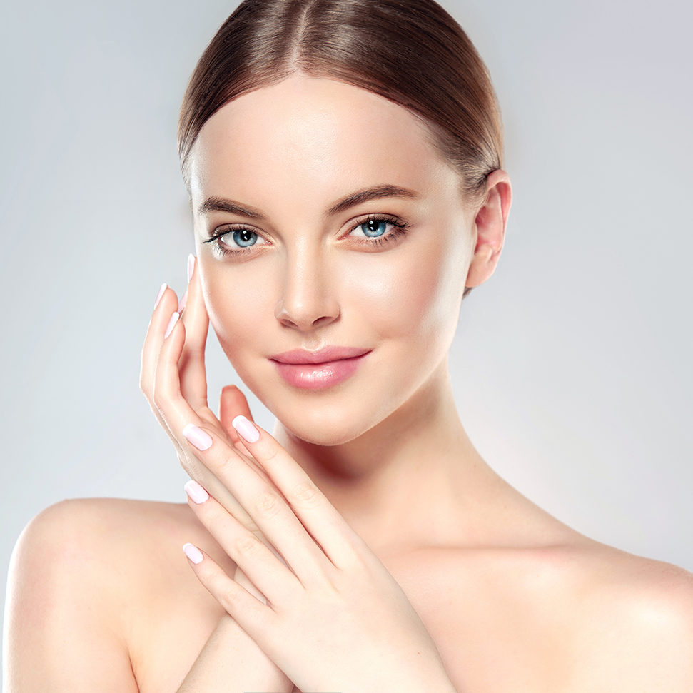 Beautiful Young Woman with Clean Fresh Skin  touch own face . Fa