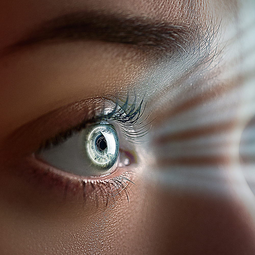 Female eye close up with smart contact lens with digital and biometric implants to scanning the ocular retina. Future concept and hi tech technology for scans to face eye identification